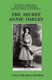 THE SECRET ANNIE OAKLEY by Marcy Heidish
