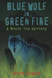 BLUE WOLF IN GREEN FIRE by Joseph Heywood