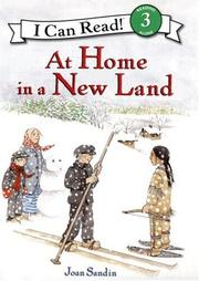 AT HOME IN A NEW LAND by Joan Sandin